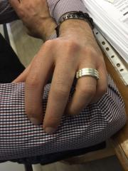 Atlantis ring on client's hand